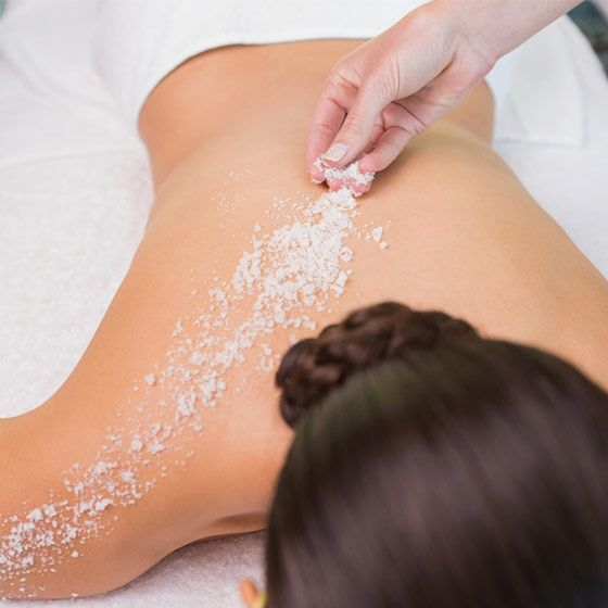 Woman gets a body scrub treatment